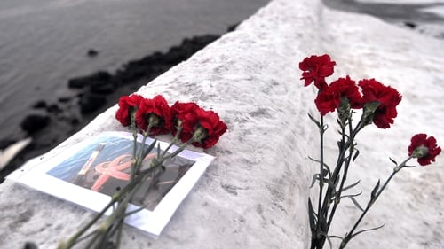 Flowers left by locals for the men feared dead after their trawler capsized in Russia's Barents Sea