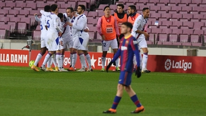 Enrique 'Kike' Garcia of SD Eibar is mobbed after his goal against Barcelona