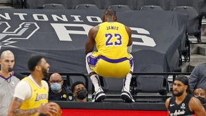 Anthony Davis laughs after LeBron James jumped on the table at the end of second half action at AT&T Center in San Antonio