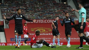 Referee Michael Oliver awards a penalty to Manchester United after Paul Pogba was challenged by Douglas Luiz