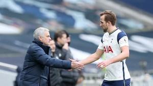 Mourinho shakes hands with Harry Kane as he leaves the pitch