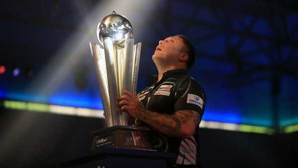 Gerwyn Price lifts the Sid Waddell trophy after winning the World Championship at Alexandra Palace