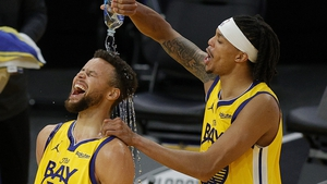 Steph Curry (L) is showered in water by Damion Lee