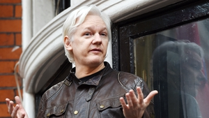 Julian Assange speaks to the media from the balcony of the Ecuadorian Embassy in London in May 2017
