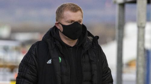 Celtic manager Neil Lennon preparing to board the flight to Dubai on Saturday
