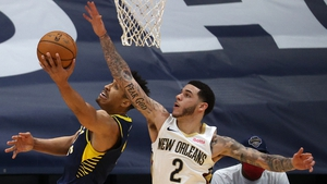 Malcolm Brogdon of the Indiana Pacers evades the New Orleans Pelicans Lonzo Ball