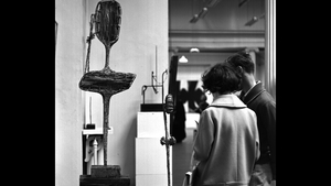Gallery visitors examine a Hilary Heron sculpture at the Living Art Exhibition at the National College of Art, Dublin in 1963. Photo: RTÉ Stills Library