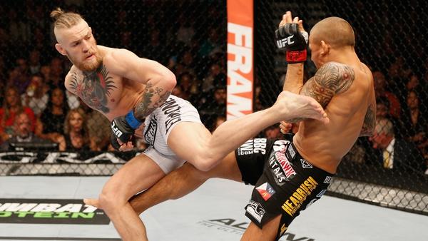 McGregor lands a kick on Poirier at UFC 178 in 2014