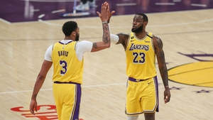 Anthony Davis and Bron James give each other a high five during the Memphis Grizzlies match