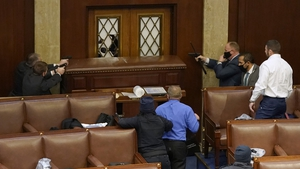 Guns were drawn as protesters tried to storm the House of Representatives chamber