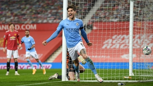 John Stones scores the opening goal at Old Trafford