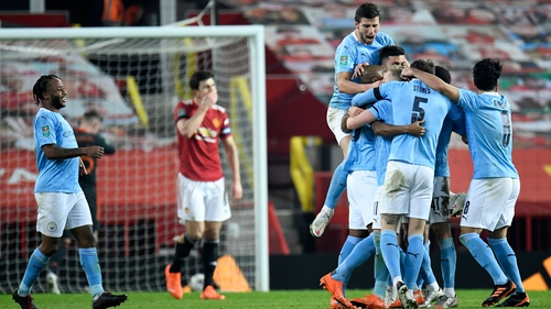City players celebrate their second goal at Old Trafford