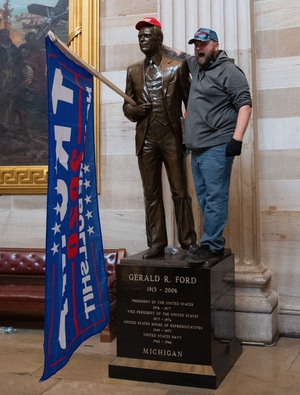 One Trump supporter posed with a Gerald Ford statue
