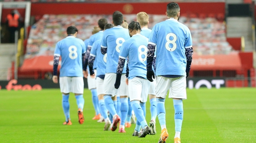 Manchester City players walk out at Old Trafford in tribute No 8 shirts in honor of Colin Bell