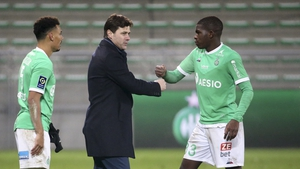 Mauricio Pochettino fist bumps Lucas Gourna-Douath of Saint-Etienne