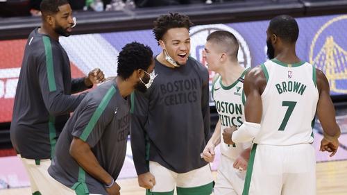 Payton Pritchard #11 of the Boston Celtics celebrates with his team-mates