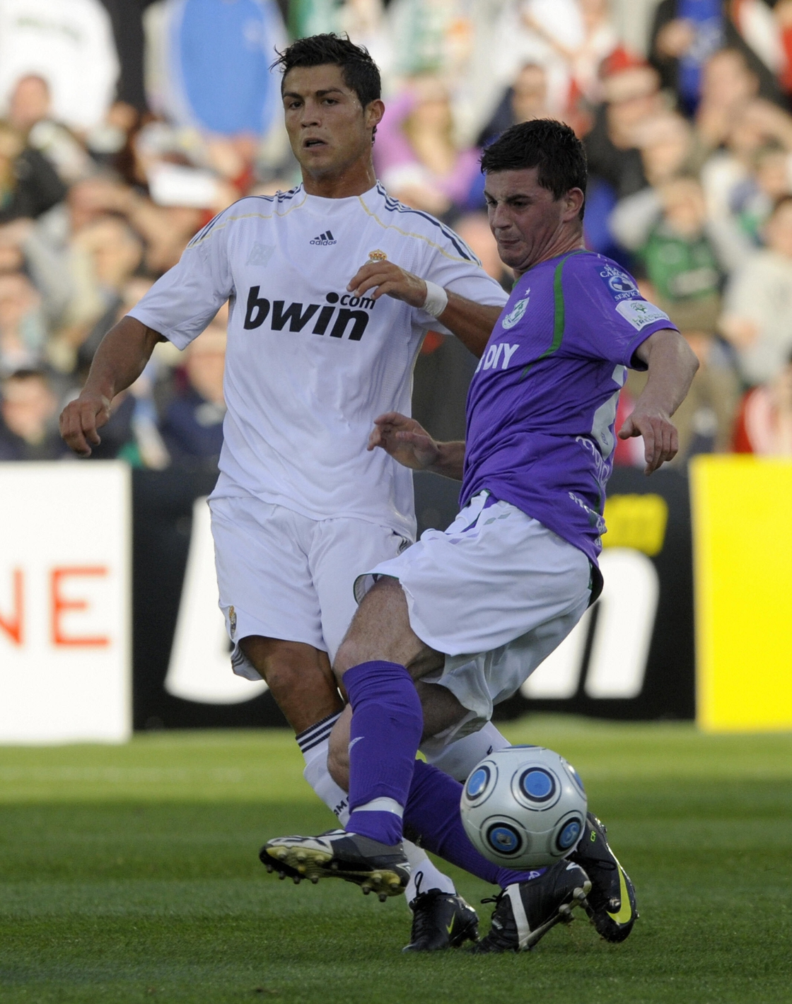 Image - Cristiano Ronaldo vies with Padraig Amond during a 2009 friendly