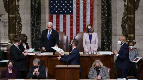 Vice President Mike Pence and House Speaker Nancy Pelosi read the final certification of Electoral College votes