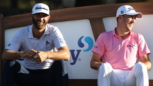 Dustin Johnson (L) and Justin Thomas share a laugh at the 18th tee