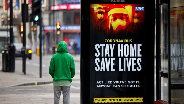 An NHS sign in central London urging people to stay at home