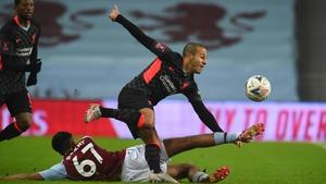 Thiago Alcantara is tackled by Aston Villa's Arjan Raikhy
