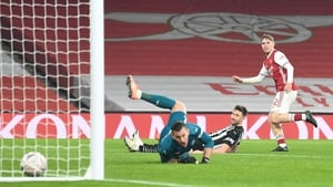 Emile Smith Rowe watches his effort cross the line to set up the Arsenal win