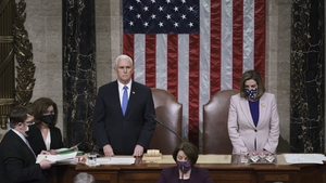 Vice President Mike Pence and Speaker of the House Nancy Pelosi read the final certification of Electoral College votes