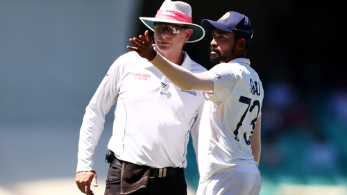 India's Mohammed Siraj alerts umpire Paul Reiffel of the taunting he experienced behind his fielding position