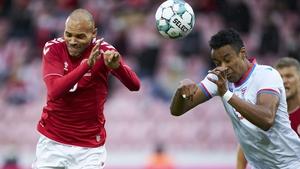 Sonni Ragnar Nattestad beats Denmark's Martin Braithwaite to a header during an international friendly in October