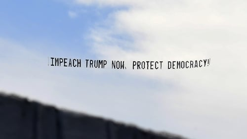 A banner towed by a plane in Florida calling for Donald Trump to be impeached
