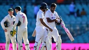 India's Ravichandran Ashwin and Hanuma Vihari walk off the field at the end