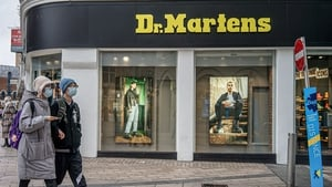 Dr Martens has posted a 22% rise in annual core earnings with online sales helping to soften the hit from Covid-19-related store closures