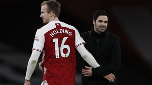 Rob Holding (L) and Arsenal manager Mikel Arteta