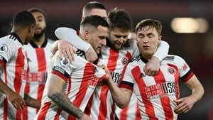 Sheffield United players celebrate Billy Sharp's penalty against Newcastle. It sealed their first Premier League win of the season after 18 games.