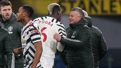Man United manager Ole Gunnar Solskjaer congratulates match-winner Paul Pogba at Turf Moor