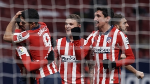 Saul Niguez celebrates with Luis Suarez and Kieran Trippier after scoring Atletico's first goal