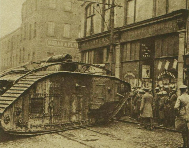 tank being used to break open the door of a shop in Dublin during a search for arms Photo: Illustrated London News [London, England], 22 January 1921