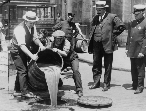 New York City Deputy Commissioner John A. Leach watching agents pour liquor into a sewer following a raid Photo: Library of Congress Prints and Photographs Division Washington, D.C. 20540 USA