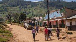 People walk in a town near Bwindi Impenetrable National Park, in Uganda