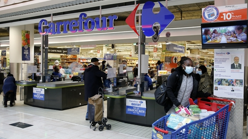 Couche-Tard made a non-binding offer on Wednesday for France's Carrefour grocery group, largely in cash