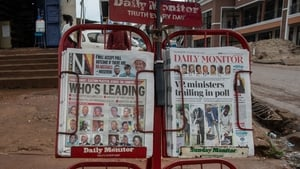 Front pages of newspapers covering the election in Uganda