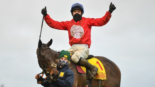 Darragh O'Keeffe celebrates after riding A Plus Tard to victory in the Savills Steeplechase at the Leopardstown Christmas Festival