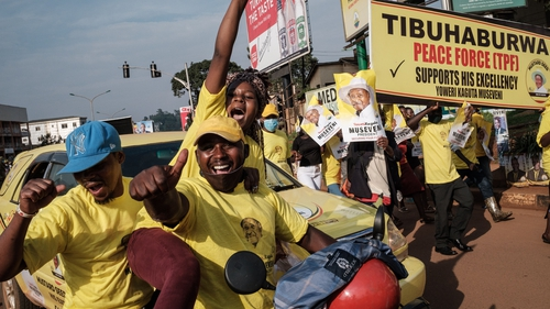 Supporters of incumbent Ugandan Presdent Yoweri Museveni celebrate in the streets of Kampala today