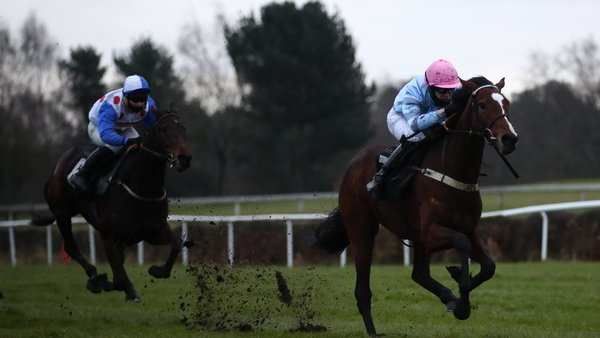 Paul O'Brien riding Eileendover (right) on their way to winning the Alan Swinbank Mares' Standard Open National Hunt Flat Race
