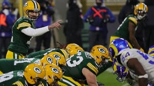 Aaron Rodgers of the Green Bay Packers calls a play
