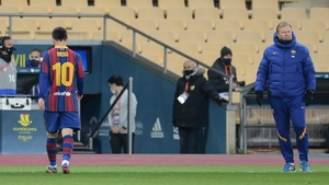 Lionel Messi leaves the pitch after being sent off