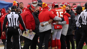 Patrick Mahomes is assisted off the field after an injury from a sack