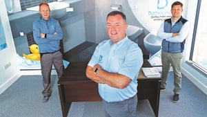 Alan O'Sullivan, CEO of Bathrooms 4U with Seamus Scanlon (left), Director, and Alan Kelly (right), Sales Manager