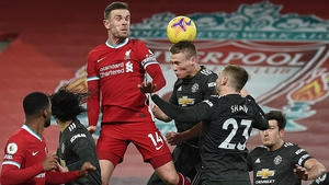 Liverpool captain Jordan Henderson rises to meet a header against Manchester United