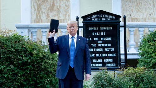 Donald Trump holds a Bible while visiting St John's Church across from the White House after the area was cleared of people protesting the death of George Floyd